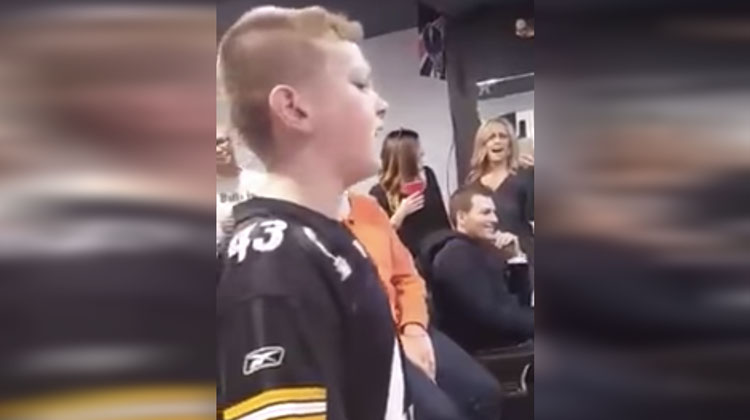 boy singing with shocked family