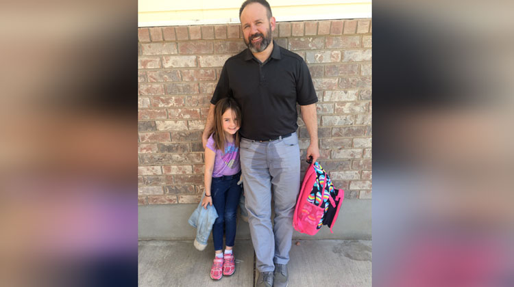 dad with water stain on pants with daughter