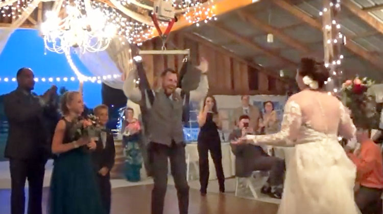 paralyzed groom standing with surprised bride walking towards him