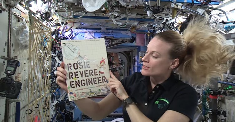 astronaut reads in space