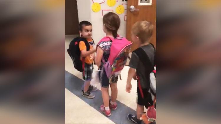 kindergarten students shaking hands
