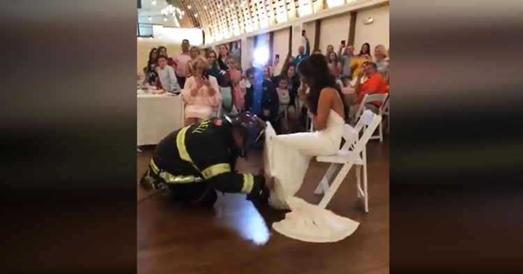 17dfb18a245 Firefighter Groom Pulls Out Full Gear To Retrieve Garter In Hilarious Video.