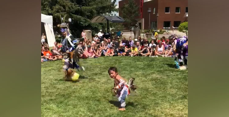 little boy dancing at pow-wow