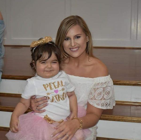 3 year old Skye Savren-McCormick flower girl