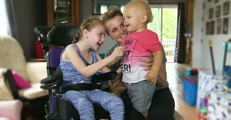girl with cerebral palsy and baby brother