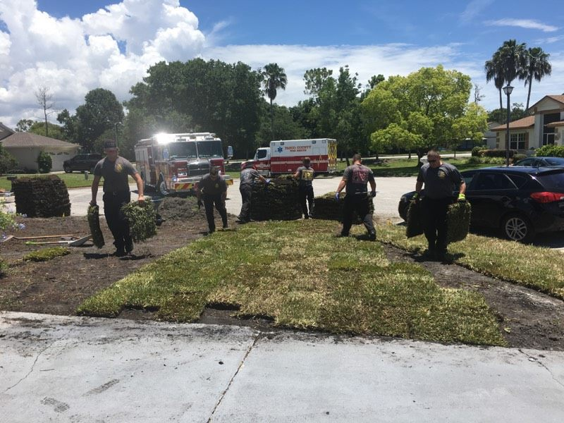 firefighters lay sod for man after heart attack