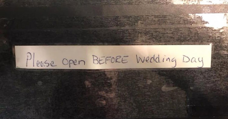 package that says 'please open before wedding day'