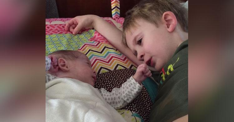 brother sings preemie sister