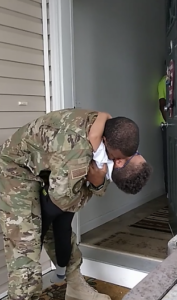dad hugs son