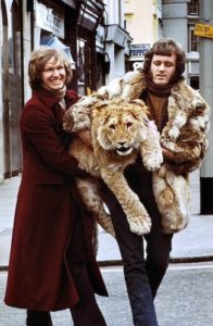 john and anthony carrying lion