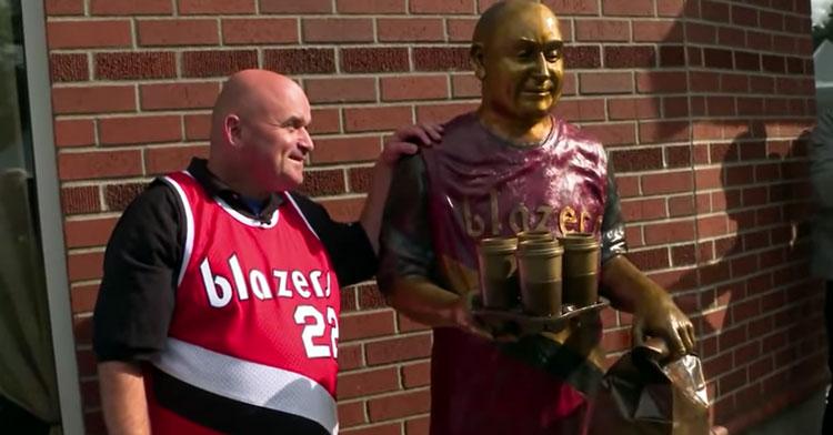 man next to statue