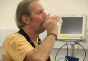 man holds cup