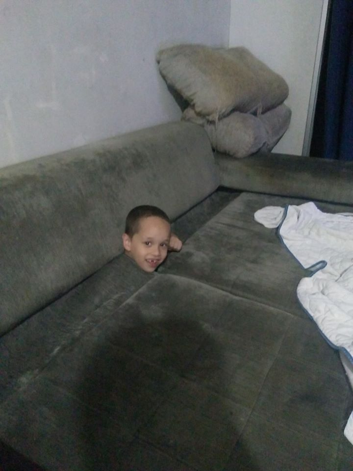 Little Boy Hilariously Gets Stuck Couch