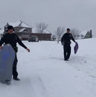 cops hold sleds