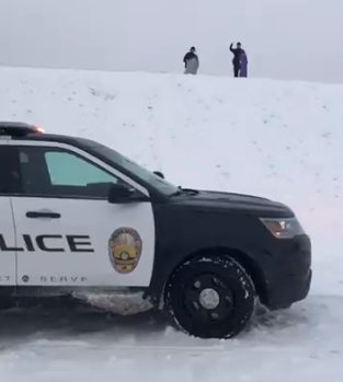 cops on sledding hill