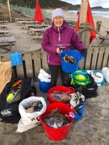 pat cleans beach