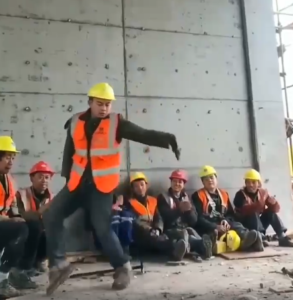 construction worker dances
