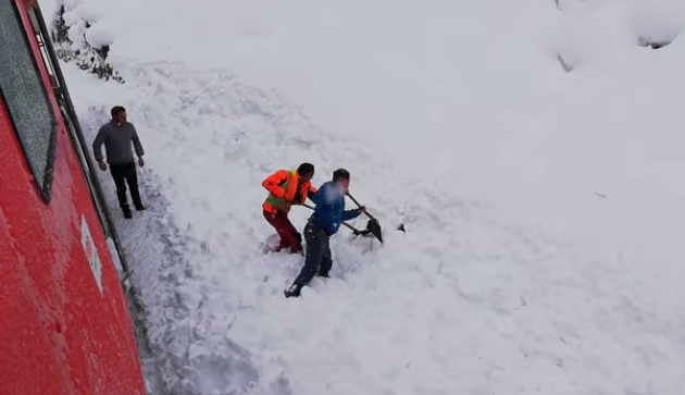 workers dig in snow