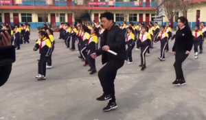 students dance with principal