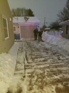 firefighters shovel driveway