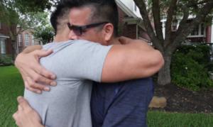 christian hugs dad