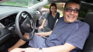 dad in new car