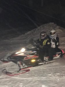 pharmacist on snowmobile