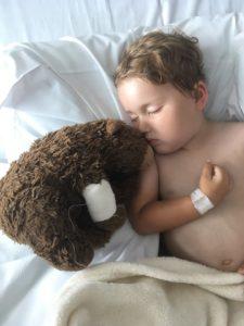 atticus cuddles his teddy bear