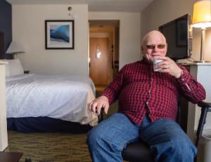 glenn in his hotel room