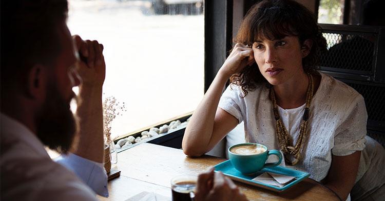 couple talking coffee shop