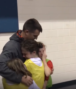 drew hugs his daughters
