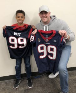 brock and watts hold up jerseys
