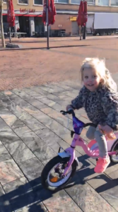 pomme wins the race on her bike