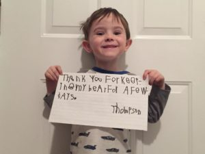 thompson holds up thank you note