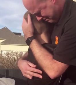 cayson hugs his dad