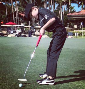 tommy golfing