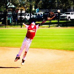 tommy playing baseball