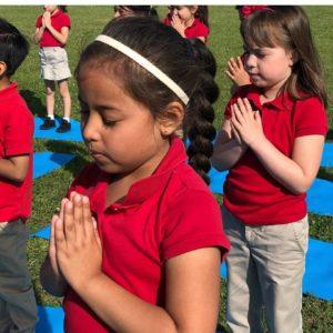 kids practice yoga