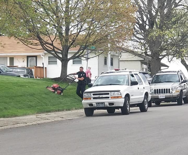 officer banks mows lawn