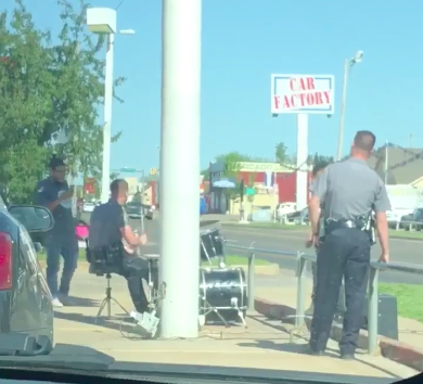drumming cop