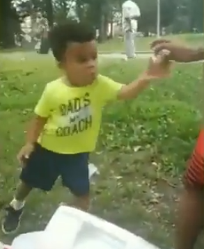 kid dances for donut