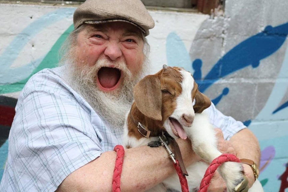 We've Never Seen A Grown Man Happier Than This Guy Meeting A Baby Goat.