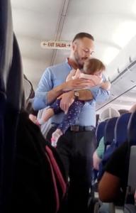 flight attendant comforts baby