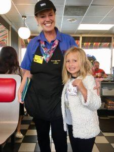 waitress gives girl earrings