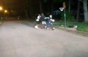 cop joins basketball game
