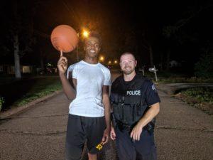 cop teens plays basketball