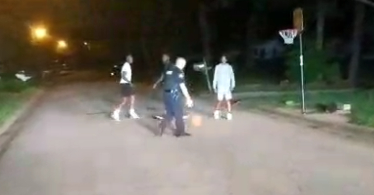cop playing basketball