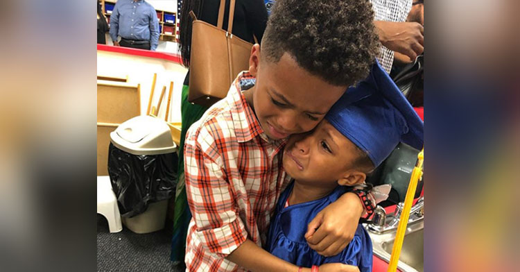 preschool graduation hug