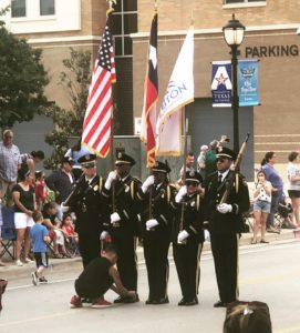 boy ties honor guard member's shoe