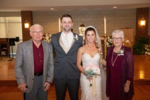 newlyweds with grandparents